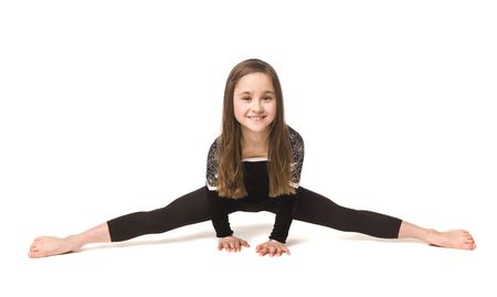 Young girl doing gymnastics isolated on white background photo