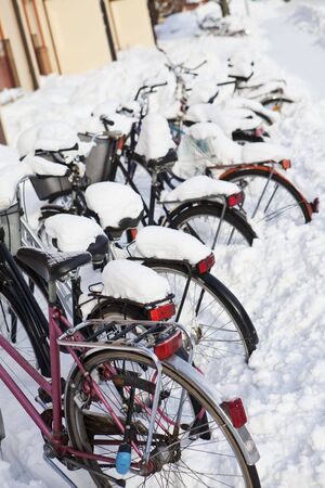 Parked Bicycles at wintertime photo