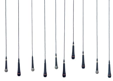 using voice: Isolated microphones in a row Stock Photo