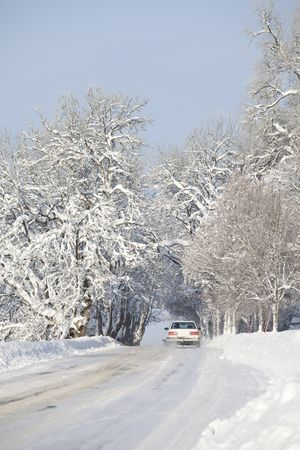 driving conditions: Car from behind on winter Road Stock Photo