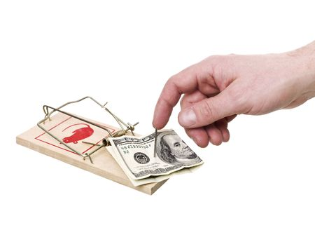 Mousetrap with dollars and a hand Stock Photo - 6827840