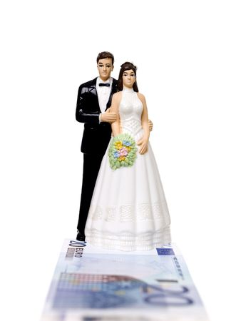 tarnish: Wedding couple standing on a Euro Bank Note isolated on white background