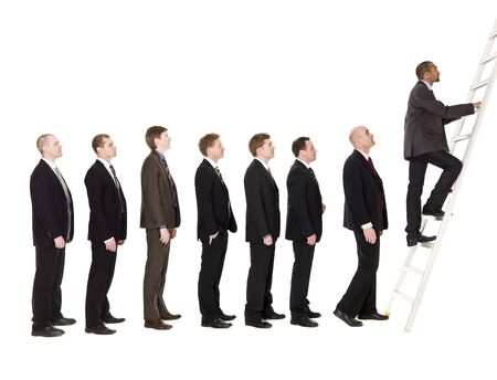 to queue: Group of men standing in a line, waiting to climb a ladder