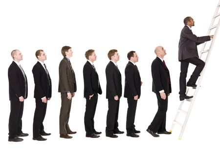 Men in line waiting to climb a ladder photo