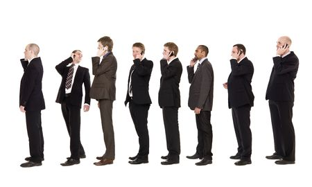 Businessmen on a line using their cellphones photo