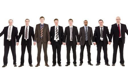 Businessmen in a row holding hands Stock Photo - 6877916