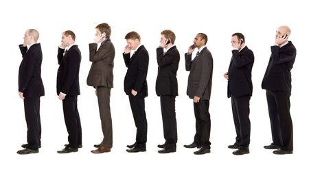 Nine businessmen on the phone isolated on white background photo
