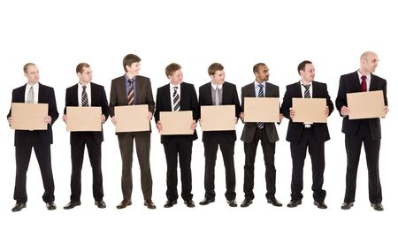 man isolated: Men in a row holding signs isolated on white background