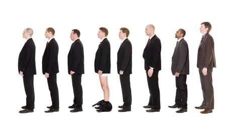 Man with his pants down standing in line together with other men photo