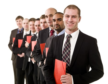 Business men in a row with red documents photo