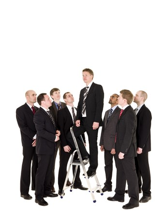 stair well: Manager standing on a step ladder with his team around
