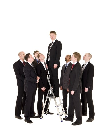 stair well: Manager standing on a step ladder with his business team around