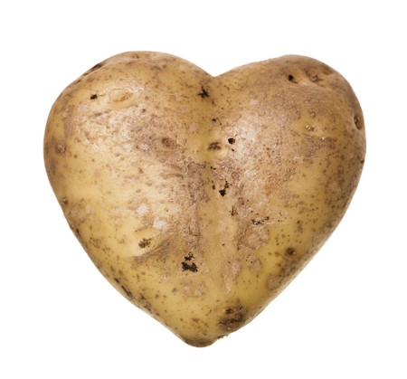 Heartshaped Potato isolated on white background