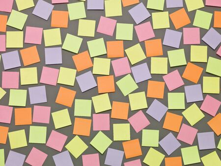Adhesive Notes with different colors on grey background photo