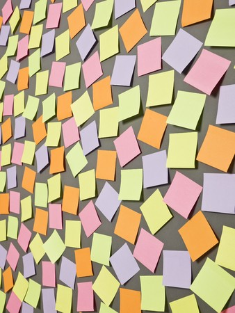 Adhesive Notes with different colors on grey background Stock Photo - 7039493