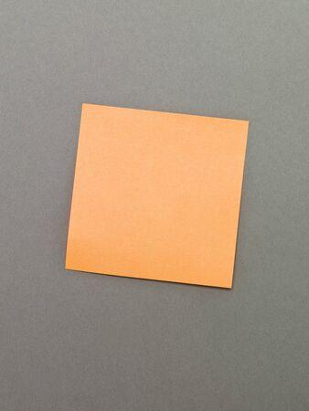 billboard posting: Orange Adhesive Note on grey background Stock Photo