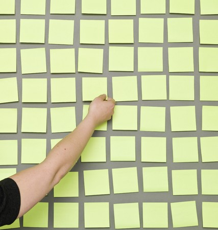 color images: Human take an Adhesive Note from a wall Stock Photo