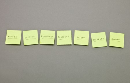 weekdays: Adhesive Notes with the weekdays in a row on grey background