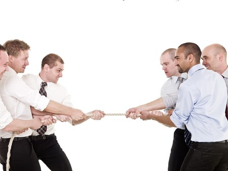 Businessmen in a tug-of-war isolated on white background photo