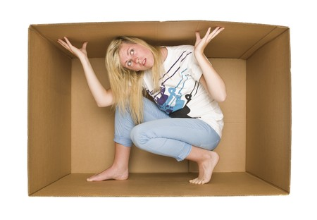 crowded space: Young Woman inside a Cardboard Box isolated on white Backgreound