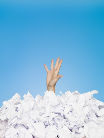 Human buried in papers on blue background photo