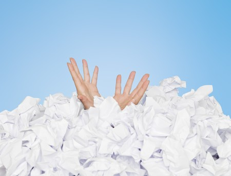 finance a helping hand confusion: Human buried in white papers on blue background