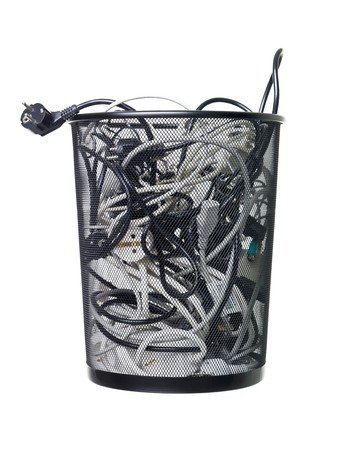 wastebasket: Electric wires in a wastebasket isolated on white background