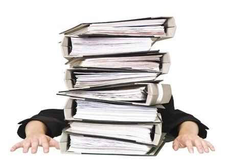 office physical pressure paper: Human behind a stack of Folders isolated on white background Stock Photo