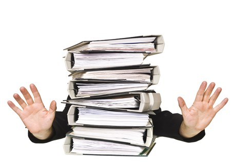 Human behind a stack of Ring Binders isolated on white background photo