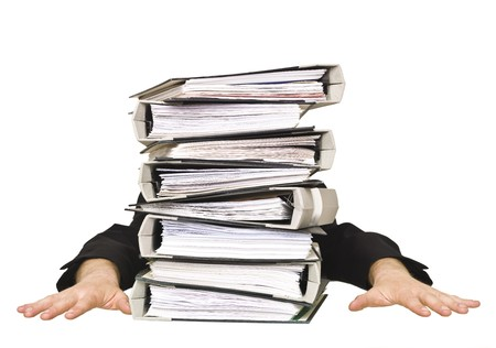 office physical pressure paper: Human behind a stack of Ring Binders isolated on white background