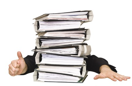 office physical pressure paper: Human doing thumbs up behind a stack of Ring Binders