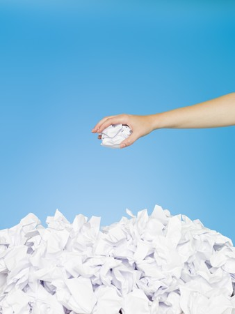 finance a helping hand confusion: Hand with white paper on blue background