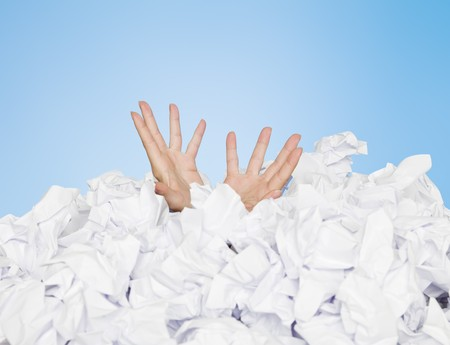 Human buried in papers on blue background