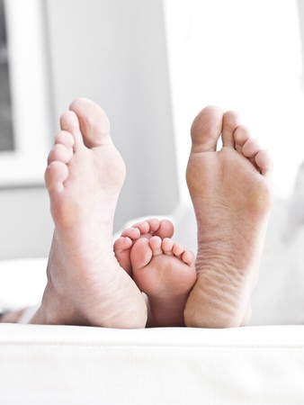 safeness: Adults och Childrens sole of feets Stock Photo