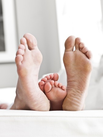 Adults and Childrens sole of feets Stock Photo - 7199453