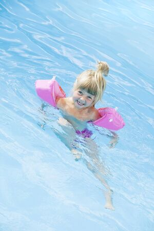 Young girl in a swimming-pool with water wings Stock Photo - 7570653