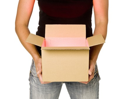 Woman holding a heavy cardboard box isolated on white background photo