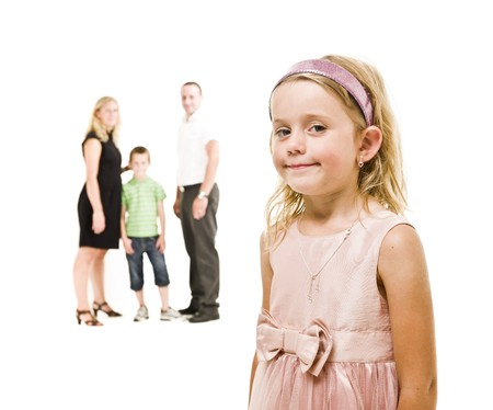 Young girl in front of her family isolated on white background Stock Photo - 7587448