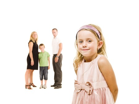 Young Girl in front of her family isolated on white background Stock Photo - 7587497