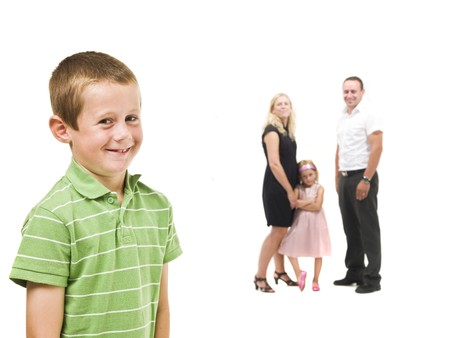 Young boy in front of his family isolated on white background Stock Photo - 7587445