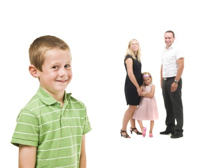 Young boy in front of his family isolated on white background Stock Photo - 7587435
