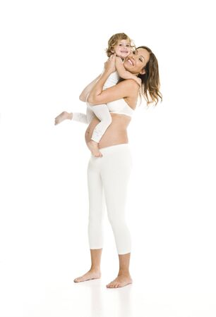 Pregnant woman with her daughter isolated on white background Stock Photo - 7670997