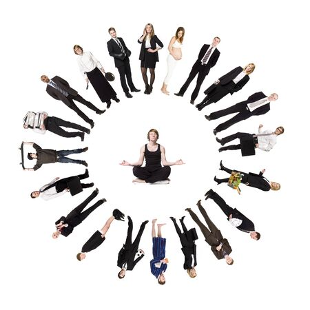 Circle of real people with a man meditating in the middle photo