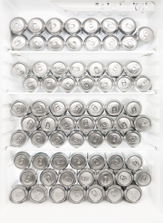 beverage fridge: Several beer cans in the Refrigerator