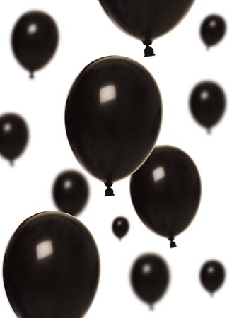 black and white photography: Black balloons isolated on white background