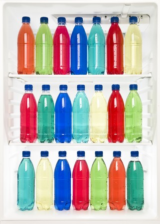 Bottles with different colors in a fridge photo