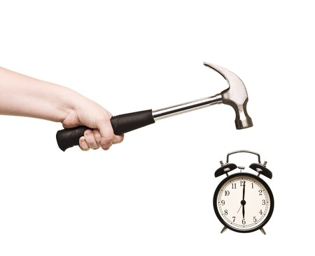 hate: Alarm Clock and hammer in hand isolated on white background Stock Photo