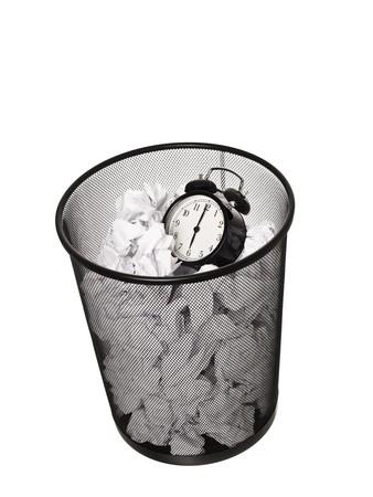 wastebasket: Alarm Clock in a Wastebasket islated on white background