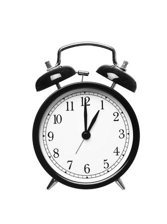o�??clock: Reloj despertador muestra las en un punto aislado en fondo blanco