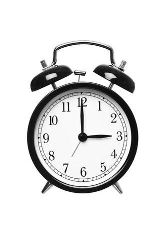 o�??clock: Reloj despertador muestra que las tres aislados en fondo blanco Foto de archivo